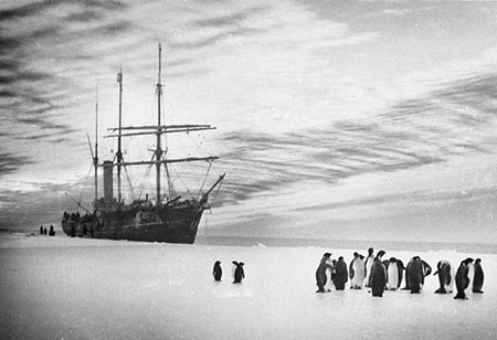 Aurora alongside the ice off Western Base, 1911-1914, by Frank Hurley.