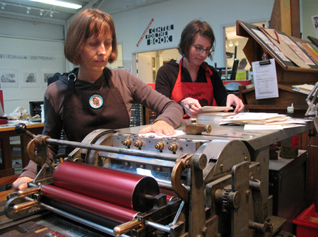 Pam DeLuco (left) and Allison Weiner at the letterpress.
